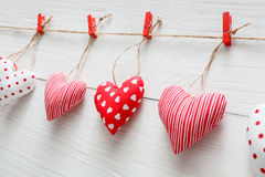 Valentine day background, pillow hearts border on wood, closeup Stock Photography