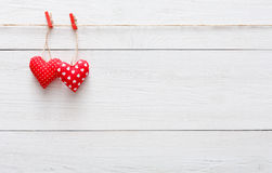 Valentine day background, pillow hearts border on wood, copy space Stock Photography