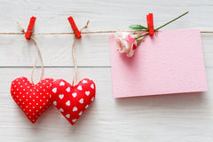 Valentine day background, pillow hearts and card on wood Stock Photo