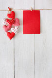 Valentine day background, pillow hearts and card on wood Stock Photography