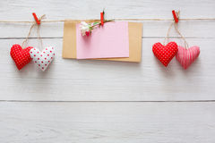 Valentine day background, pillow hearts and card on wood Stock Images