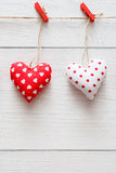 Valentine day background, pillow hearts couple on wood, copy space Stock Photo