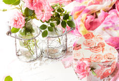 Valentine day background, pink roses, gift box, vintage post card. Valentine day background - pink roses in glass bottle, gift box and vintage post card on Royalty Free Stock Image