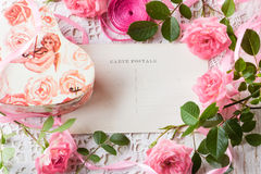 Valentine day background, pink roses, gift box, vintage post card. Valentine day background - pink roses, gift box and vintage post card with space for text on Stock Images