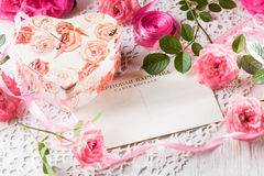 Valentine day background, pink roses, gift box, vintage post card. Valentine day background - pink roses, gift box and vintage post card with space for text on Stock Photos