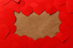 Valentine Day Background. Red paper hearts on black wooden desk with copyspace Stock Photo