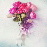 Valentine day card. Bouquet of pink roses on blue stone texture. Vintage toning. Square Stock Image