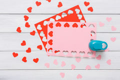 Valentine day card, craft scrapbooking background, hole punch heart form Royalty Free Stock Photos