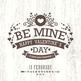 Valentine day card with floral vintage frame on wooden background Royalty Free Stock Photos