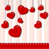 Valentine day card with hanged hearts Royalty Free Stock Photo