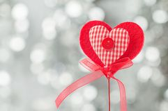 Valentine day card. With red heart on abstract silver bokeh background Royalty Free Stock Image