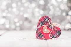 Valentine day card. With red heart on abstract silver bokeh background Stock Photos