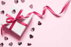 Valentine day composition: white gift box with bow and hearts. Top View. View from above royalty free stock photos