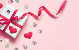 Valentine day composition: white gift box with bow and hearts. Top View. View from above royalty free stock images