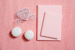 Valentine day composition: white gift boxes with bow and red felt hearts, photo template, background. Top View. View from above. Valentine day composition: white stock photography