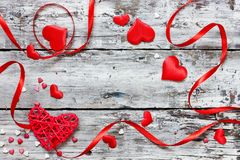Valentine day concept background red white heart confetti and ribbon on wooden background. With copy space for text royalty free stock photo