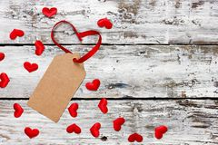 Valentine day concept background red white heart confetti and ribbon on wooden background with copy space for text. Valentine day concept background red white royalty free stock photo