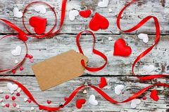 Valentine day concept background red white heart confetti and ribbon on wooden background. With copy space for text royalty free stock images