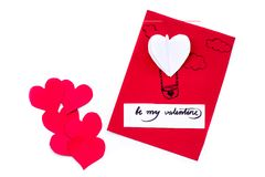 Valentine day holiday. hand made gift card with a heart balloon and an origami heart isolated on white. Valentine day concept. hand made craft. gift card with a royalty free stock images