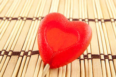 Valentine day concept - heart shaped lolly pop on wood background, copy space Royalty Free Stock Image