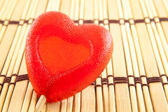 Valentine day concept - heart shaped lolly pop on wood background, copy space Royalty Free Stock Photography