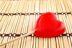Valentine day concept - heart shaped lolly pop on wood background, copy space Stock Photography