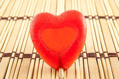 Valentine day concept - heart shaped lolly pop on wood background, copy space Stock Photos