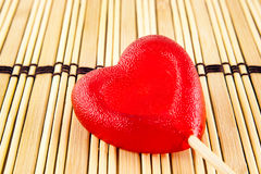 Valentine day concept - heart shaped lolly pop on wood background, copy space Stock Image
