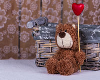 Valentine day concept. Teddy bear is sitting with a heart. Royalty Free Stock Photos