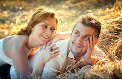 Valentine day couple in brown hay Stock Photo