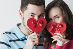 Valentine day couple. Young couple celebrating Valentine day holding paper heart cards Royalty Free Stock Photo
