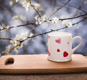 Valentine Day. Cup of tea, coffee on the wooden cutting board in the garden. Lo Stock Photo