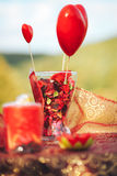 Valentine day decor.love story. decorated table ,hearts , romant. Ic dinner outdoors Stock Photos