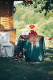 Valentine day decor.love story. decorated table ,hearts , romant. Ic dinner outdoors Royalty Free Stock Image