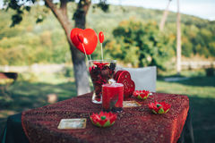 Valentine day decor.love story. decorated table ,hearts , romant. Ic dinner outdoors Royalty Free Stock Photo