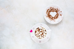 Valentine day decoration, breakfast, white vintage cup and plate, coffee with small marshmallows Stock Photo