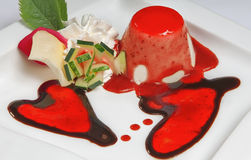 Valentine day dessert with two hearts. Valentine day dessert with two red hearts on plate Stock Images