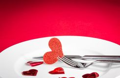 Valentine day dinner on red background Royalty Free Stock Photos