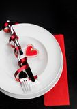 Valentine day dinner with table setting in red and elegant heart ornaments Royalty Free Stock Photos
