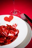 Valentine day dinner to restaurant on red table background Royalty Free Stock Images