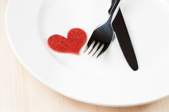 Valentine day dinner to restaurant on wood background Royalty Free Stock Image
