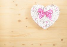 Valentine day gift with ribbon on wood table Stock Photography