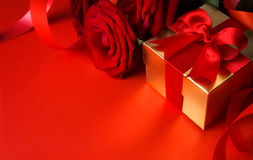 Valentine Day golden gift box and red roses Stock Image