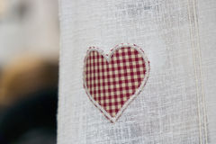 Valentine day heart on curtain Stock Images