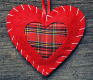 Valentine day heart pillow. On wooden background stock images
