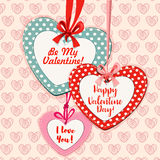 Valentine Day heart shaped greeting card design. Valentine Day greeting poster. Heart shaped Valentine cards hanging on red and pink ribbons with bows, decorated Royalty Free Stock Photos