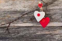 Valentine Day hearts on branch on wooden background. Valentine day card. Copy space, Royalty Free Stock Photo