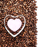 Valentine Day Holiday over coffee beans background isolated. Royalty Free Stock Images