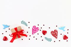 Valentine day layout. Pink gift with hearts, candles and confetti on a white background. St. Valentines Day, day love, February 14. Concept. Copy space, top stock photos