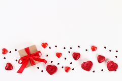 Valentine day layout. Pink gift with hearts, candles and confetti on a white background. St. Valentines Day, day love, February 14. Concept. Copy space, top royalty free stock photography
